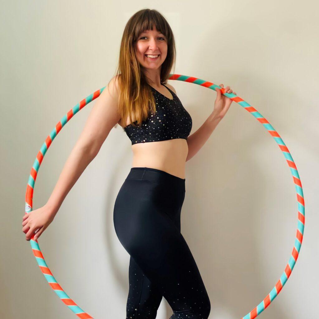 woman holding hula hoop hula hoop class instructor training